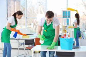 UK Cleaning services team working in office - Contract Cleaning in London