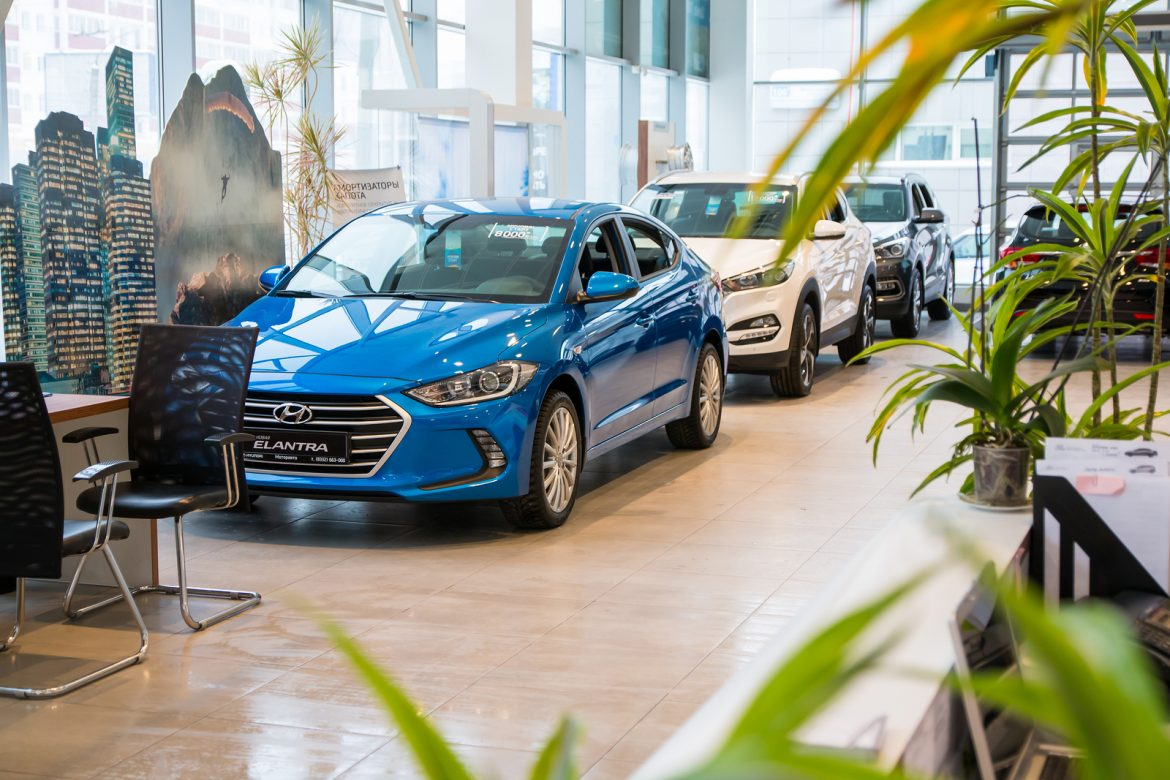 Cleaning Services UK - Russia Kirov - December 06 2016: Showroom and car of dealership Hyndai in Kirov city in 2016