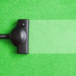 UK Contract Cleaning - vacuum cleaner on the floor showing house cleaning concept